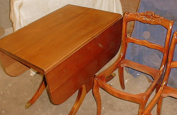 Unusual drop leaf table with hidden extra leaf mechanism that stores leaf  just under table. Duncan Phyfe table with rich mahogany veneers. - Cedarberry Furniture Refinishers/Chair Caning/Custom Furniture